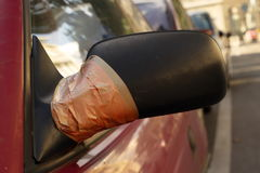 Damaged rearview mirror repaired Stock Images