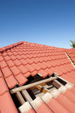Damaged red tile roof construction Royalty Free Stock Photography