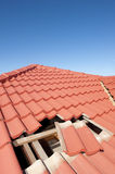 Damaged red tile roof construction house Royalty Free Stock Image