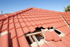 Damaged red tile roof construction house royalty free stock images