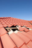 Damaged red tile roof construction house Stock Image