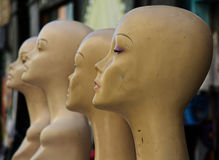 Damaged retro female Mannequins in a line Royalty Free Stock Photography
