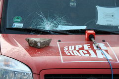 Damaged during riots. Polish television station (Superstacja) car with broken glass, damaged during street riots Stock Photo