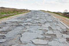Damaged road. Very bad condition damaged road that needs repair Stock Photo