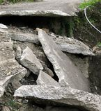 Damaged Road. A narrow road destroyed by an earthquake or landslide Royalty Free Stock Images