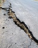 Damaged Road. A road is being destroyed by a landslide Stock Photo