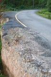 Damaged road from landslide on mountain. Damage road from landslide in Thailand Royalty Free Stock Photo
