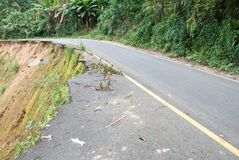 Damaged road from landslide on mountain. Damage road from landslide in Thailand Stock Photo