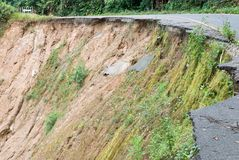 Damaged road from landslide on mountain. Damage road from landslide in Thailand Royalty Free Stock Image