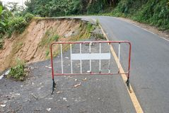 Damaged road from landslide on mountain. Damage road from landslide in Thailand Stock Photos