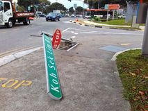 Damaged road sign. A damaged road sign at a junction in Singapore Royalty Free Stock Photography