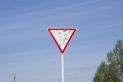 Damaged road sign & x22;give way& x22; Royalty Free Stock Images