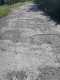 The rural roads deteriorate. The damaged roads in rural areas that require repair Royalty Free Stock Image
