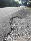 The rural roads deteriorate. The damaged roads in rural areas that require repair Stock Photo