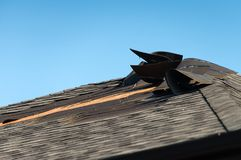 Damaged roof with blown shingles Royalty Free Stock Images