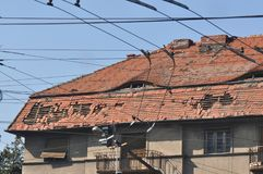 Damaged roof. Damaged slope roof from tiles after storm stock image