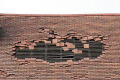 Damaged roof with a large hole Royalty Free Stock Image