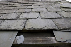 Damaged roof with missing slates Royalty Free Stock Images