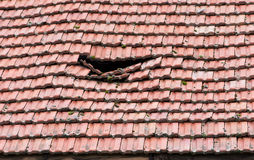 Damaged roof. Old damaged slope roof from tiles Stock Images