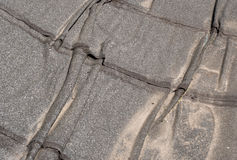 Damaged  roofing felt. Damaged insulation layer of the roof. Destruction flat roof due to temperature changes. Damaged waterproofing flat  roof. Crack roofing Stock Image
