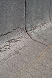 Damaged  roofing felt. Damaged insulation layer of the roof. Destruction flat roof due to temperature changes. Damaged waterproofing flat  roof. Crack roofing Royalty Free Stock Photo