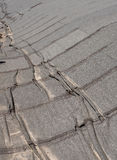 Damaged  roofing felt. Damaged insulation layer of the roof. Destruction flat roof due to temperature changes. Damaged waterproofing flat  roof. Crack roofing Stock Photography