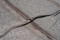 Damaged  roofing felt. Damaged insulation layer of the roof. Destruction flat roof due to temperature changes. Damaged waterproofing flat  roof. Crack roofing Stock Photo