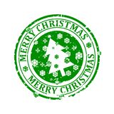 Damaged round green stamp with the words - Merry Christmas. A Christmas tree and snowflakes - vector Royalty Free Stock Photos