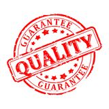 Damaged round seal with the inscription quality - guarantee Royalty Free Stock Photos