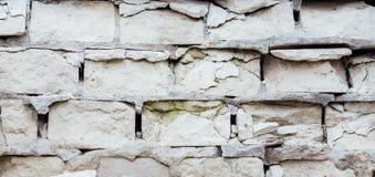 Damaged ruined masonry white brick wall, texture Stock Photo