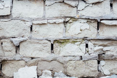 Damaged ruined masonry white brick wall, texture Royalty Free Stock Photo