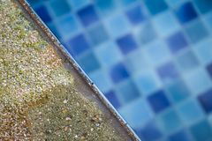 Damaged sandstone swimming pool edge by acid water from chemical. Water treatment problem Stock Images