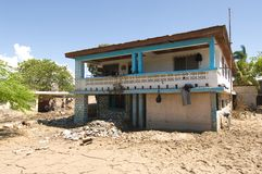 Damaged School. September 29, 2008 -A school in Gonaives, Haiti, is left buried in mud in the wake of Hurricane Ike, which deposited more than 2.2 million cubic Stock Image