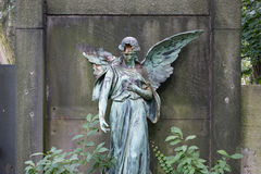 Damaged sculpture of a female angel statue. On cemetery Royalty Free Stock Photography