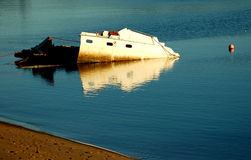 Damaged Ship Wreck. Image of partly sunken boat which was caused by a fire Stock Images