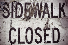 Damaged Sidewalk Closed Sign. A Grungy Sidewalk Closed Sign From A USA Highway Royalty Free Stock Image