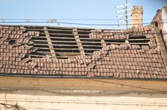 Damaged roof. Damaged slope roof from tiles after storm royalty free stock photos