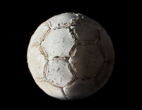 Damaged soccer ball in chiaroscuro Stock Photos