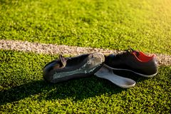 Damaged sports shoes from playing football royalty free stock photos