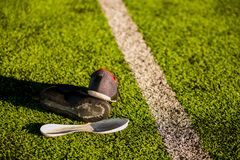 Damaged sports shoes from playing football