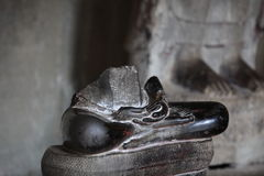 Damaged statue of Buddha. Cambodia, Angkor Wat, the remains of the sculpture of Buddha Stock Photos