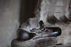 Damaged statue of Buddha Stock Photos
