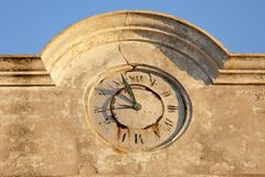 Damaged stone clock Stock Images