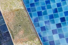 Damaged swimming pool edge from acid swimmint pool water. Water treatment problem with wrong chemical Royalty Free Stock Images