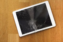 Damaged tablet computer lcd display on the floor Royalty Free Stock Images
