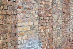 Damaged texture of a brick wall Stock Image