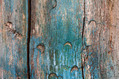 Damaged textured wooden pattern. Hardwood with crack, green blue paint Royalty Free Stock Images