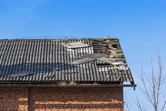 Damaged tile on the roof royalty free stock image