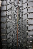 Damaged tire. A melted truck tire after nail damage Stock Images