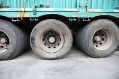 Damaged tire. On wheel of truck Royalty Free Stock Photo